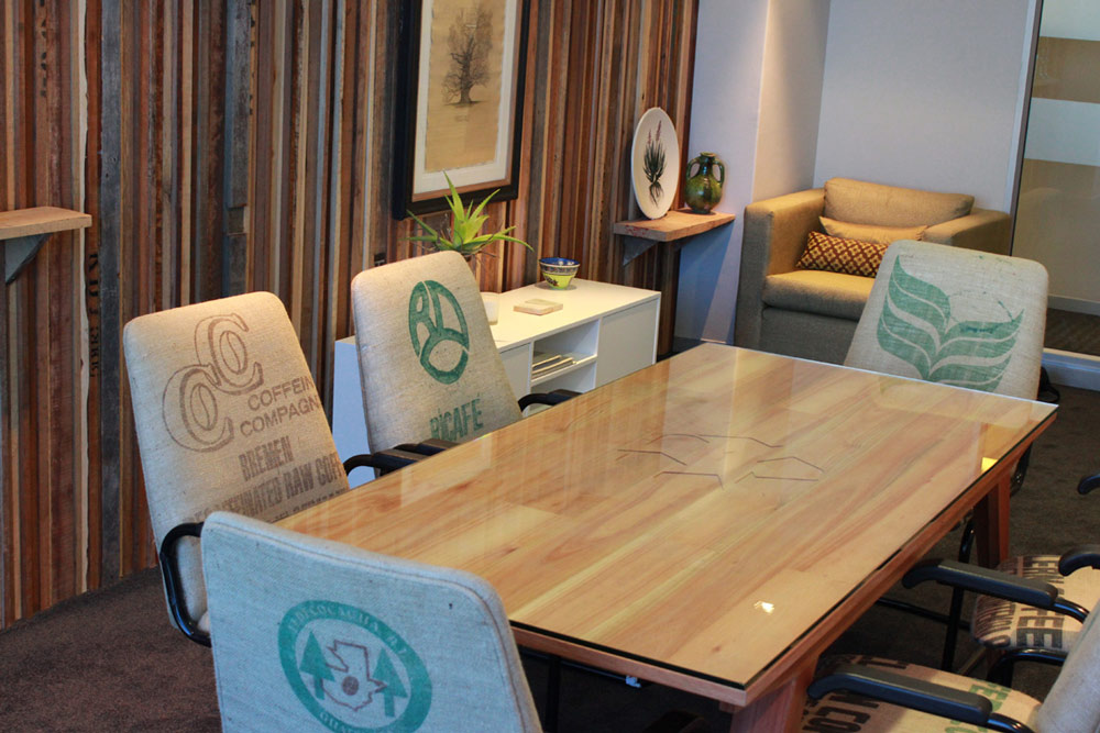 custom solid wood table with recycle icon engraving