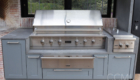 built-in barbecue with storage cabinets to hold everything needed near the grill