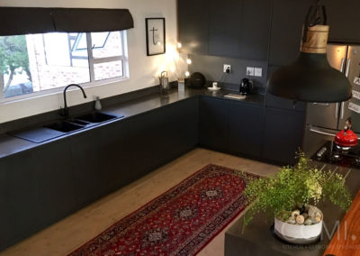 kitchen with black cabinets, black countertops and black walls
