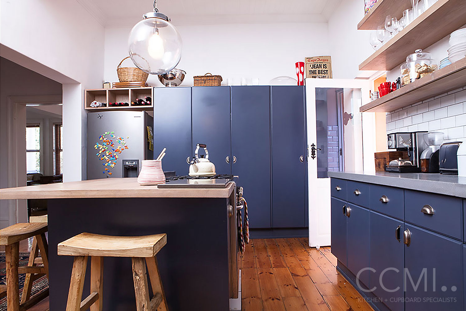 flat panel kitchen cabinets with vintage styled handles create a twist on the traditional farmstyle kitchen