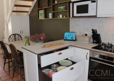Storage drawers in the kitchen provide easy access to crockery which would usually be stored in cabinets
