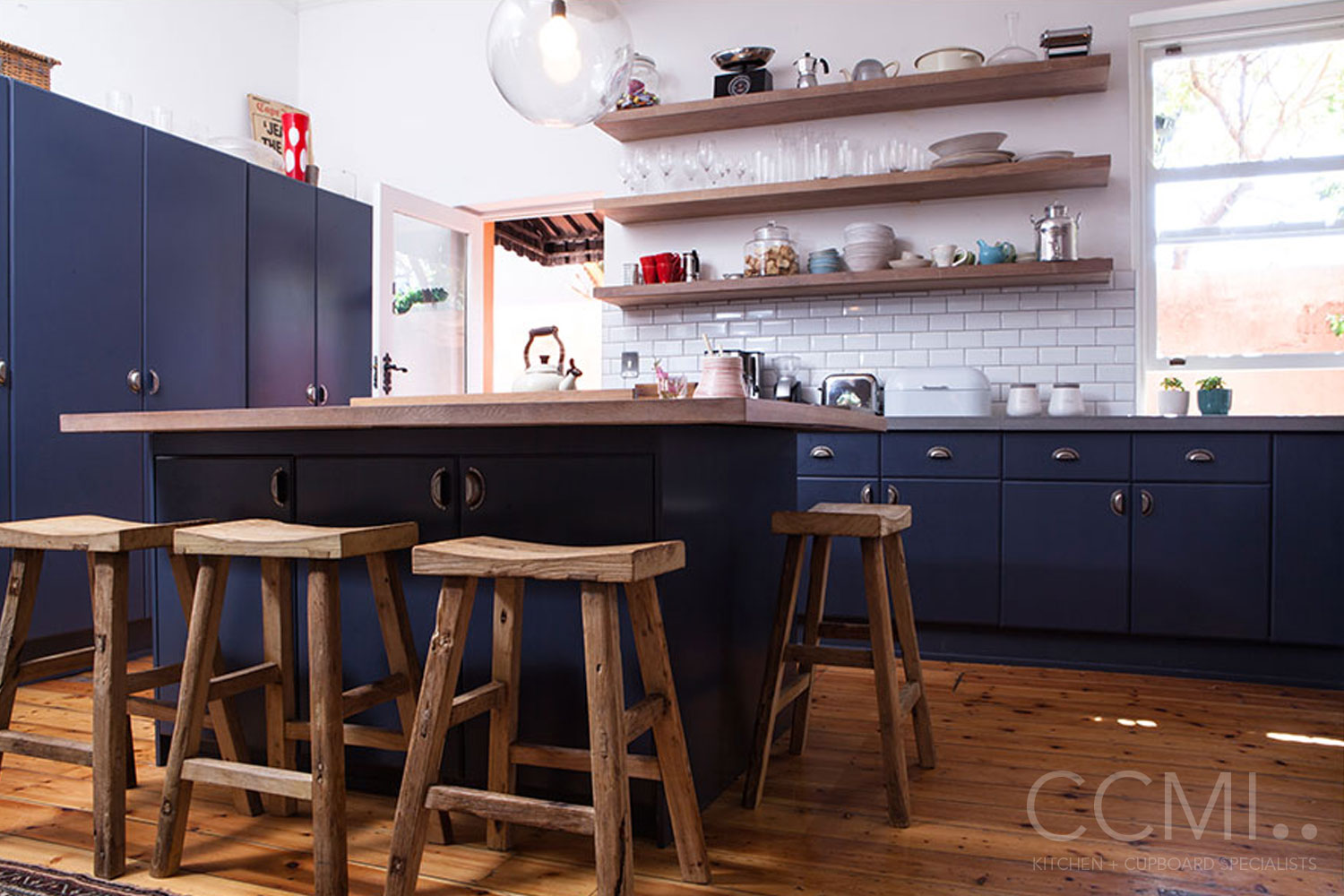 beautiful tableware displayed on open shelves that echo the wooden elements of the original oak flooring