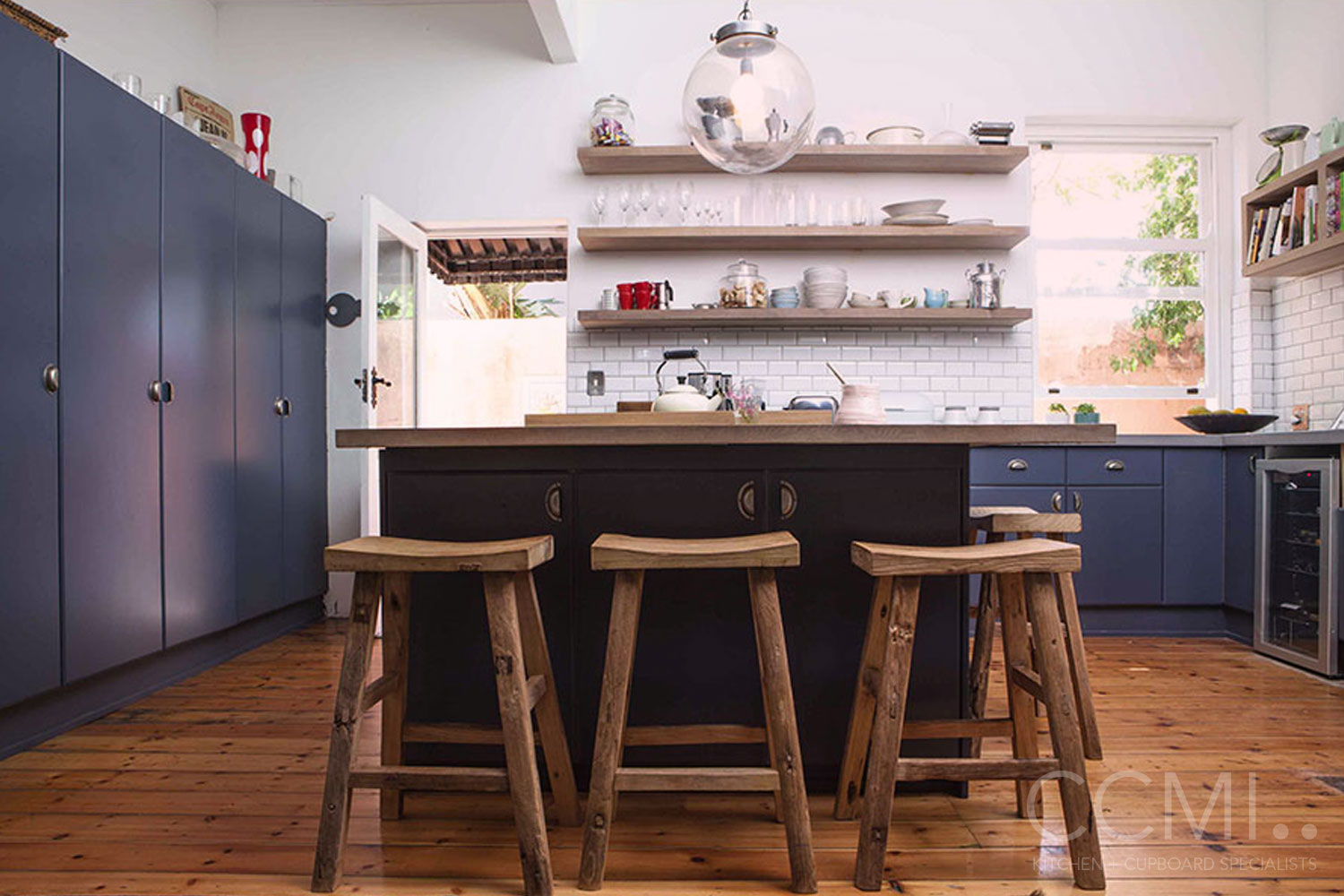 play to the strengths of an older property by furnishing accordingly, rustic stools work well here