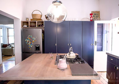 the kitchen island here has a gorgeous solid wood top, whilst the prep area is clad in concrete