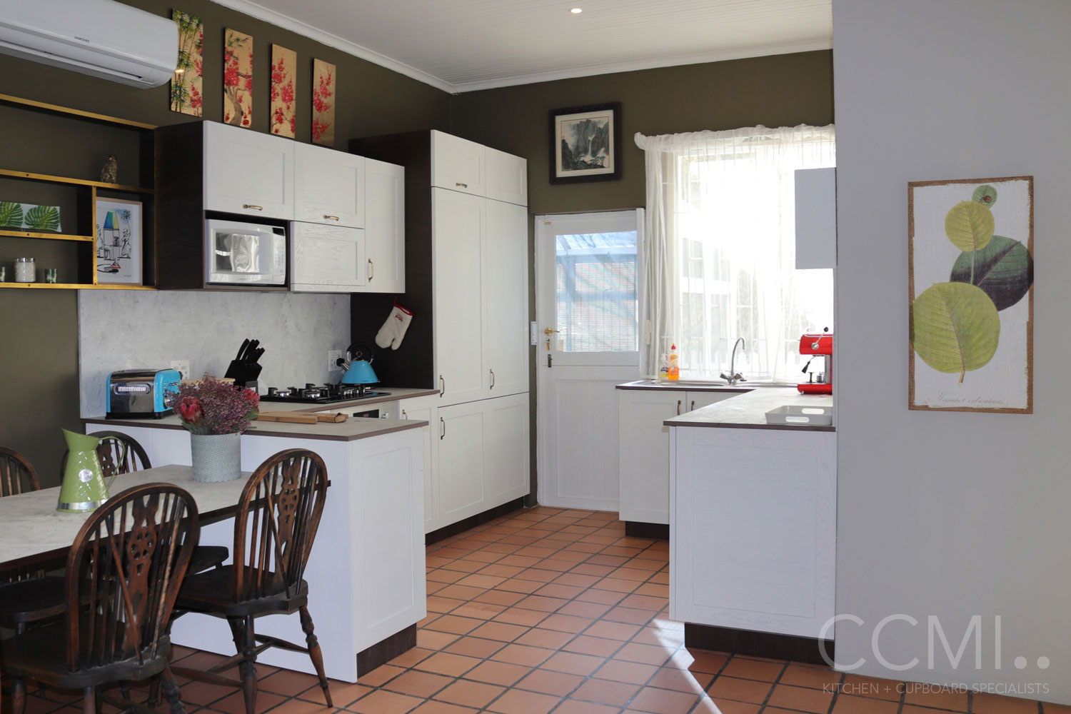 a dual L-shaped kitchen layout allows for ease of flow