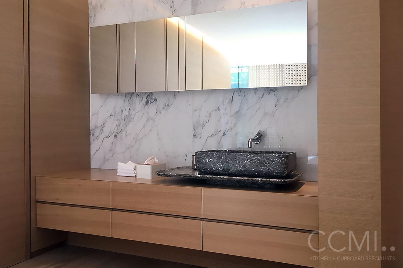 scandinavian style floating bathroom vanity with black marble sink