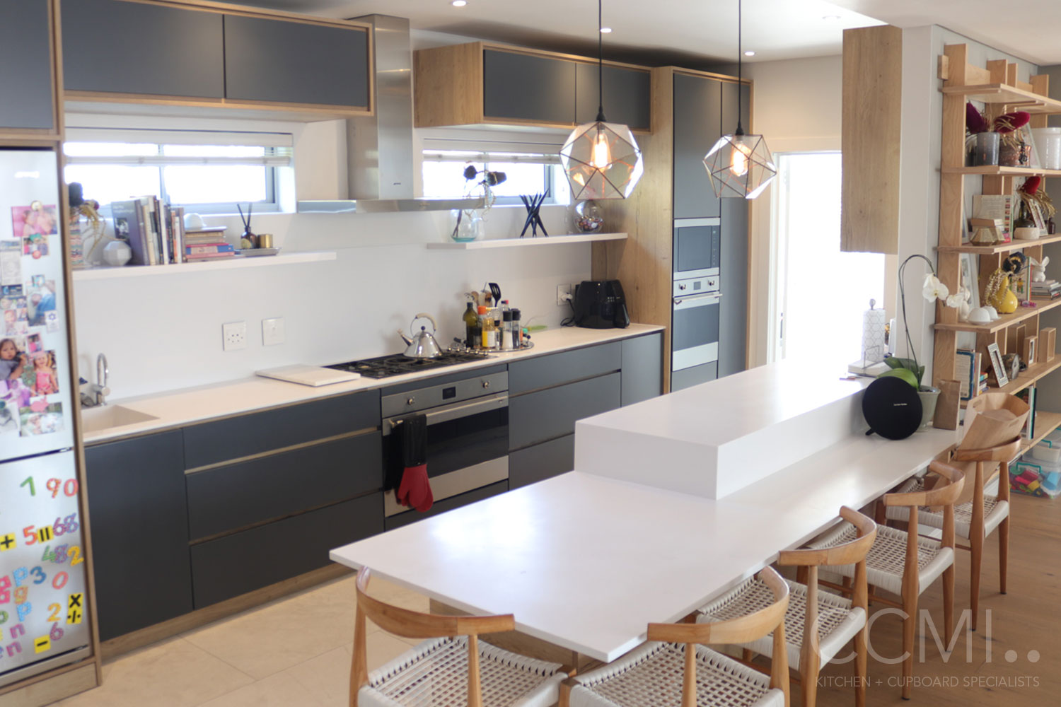 countertops split into two levels to accommodate children make this kitchen design family friendly