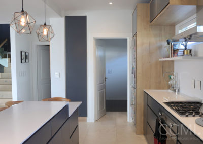 a galley layout is a great solution for a long narrow kitchen that serves as a thoroughfare