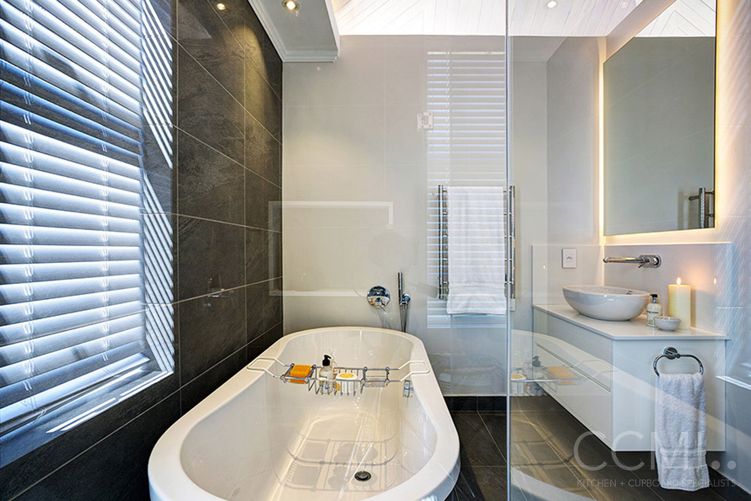 white floating vanity with towel rail