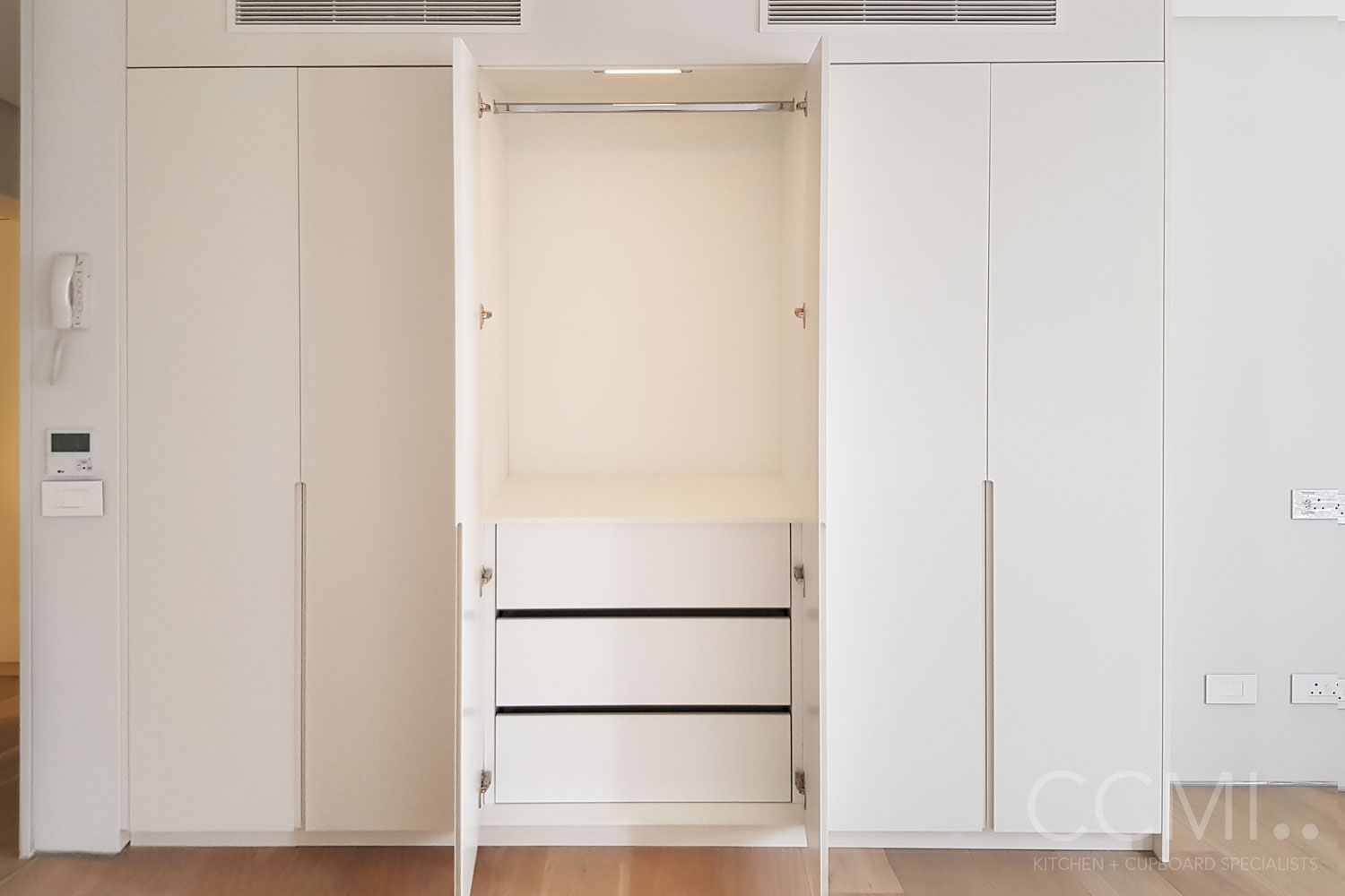 under counter built-in microwave situated in the island cabinetry